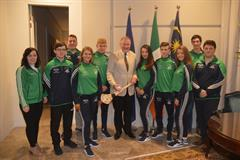 F1 Team present a signed Galway Hurley at the Irish Embassy